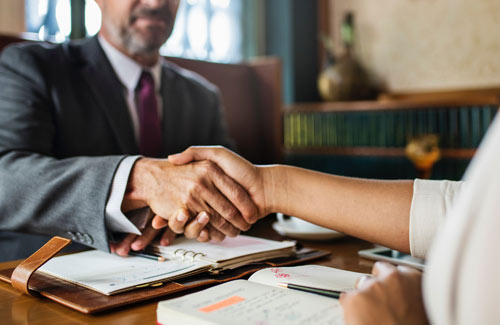 successful employee leasing confirmed with business handshake